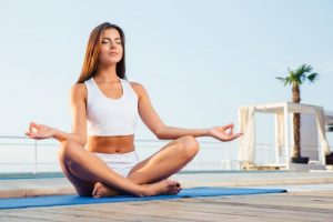 Portrait of a attractive girl meditating